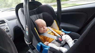 baby in a child seat